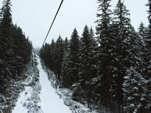 Ski lift in mountains. Ski chair lift in mountains between forest in Slovakia , low Tatras Royalty Free Stock Photos