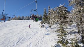 On a ski lift in mountains stock video