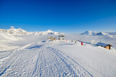 Ski lift in mountains at winter. Ski lift station in mountains at winter. Alpine winter mountain landscape. French Alps covered with snow in sunny day. Val-d` Royalty Free Stock Photography