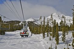 Ski Lift Moves Skiers to Mountain Top Stock Photography