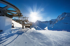 Ski lift near ski-track of Caucasus mountains Stock Photos