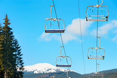 Ski lift with nobody. Empty ski lift at a ski resort in the winter Royalty Free Stock Photo