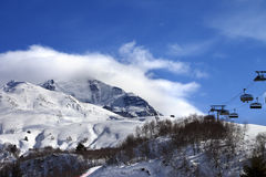 Ski-lift, off-piste slope and mountain in clouds Royalty Free Stock Image