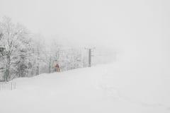 Ski lift over snow mountain in ski resort . Stock Photo