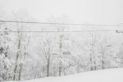 Ski lift over snow mountain in ski resort . Royalty Free Stock Photography