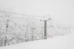 Ski lift over snow mountain in ski resort . Royalty Free Stock Photos