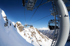 Ski lift panorama on winter resort over valley Stock Images
