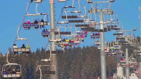 Ski lift with people stock footage