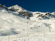 Ski lift at the Piz Clünas. The ski region of the Piz Clünas, in the Engadine Stock Image