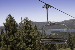 Ski Lift Ride in the Summer. Ski lift ride to the top of Snow Summit Ski Resort in Big Bear City, California. Summer time fun can be seen on Big Bear Lake with Stock Photography