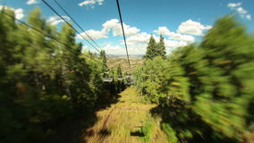 Ski Lift Ride Time Lapse Tilt Shift. V17. Ski lift ride time lapse down mountain in the summer using a tilt shift effect stock video