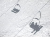 Ski lift shadow on snow Stock Images