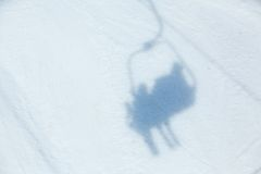 Ski lift shadow on the snow Royalty Free Stock Photography