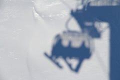 Ski lift shadow on the snow Stock Photo