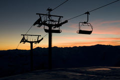 Ski-lift silhouette against sundown sky Royalty Free Stock Image