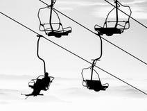 Ski lift. Silhouette ski lift over mountain royalty free stock images