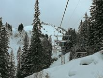 Ski lift, ski slopes and snow-capped mountains in Hoch-Ybrig, Switzerland. stock photo