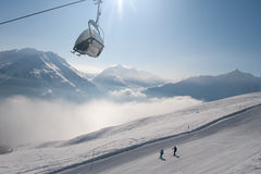 Ski lift and skiers Stock Photo