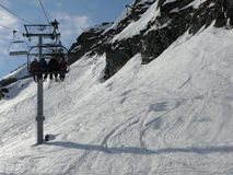 Ski lift and skiers Stock Image
