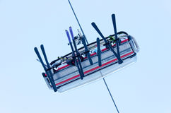 Ski lift skiers from bottom. Ski lift with skiers from bottom Stock Images