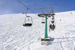 Ski lift and skiers Royalty Free Stock Image