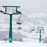 Ski lift and skiing slope Stock Photo