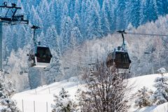 Ski lift. At the snow covered mountains background Stock Photos