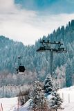 Ski lift. At the snow covered mountains background Stock Photo