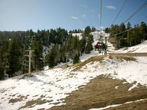 Ski lift in the snow mountain Royalty Free Stock Photo