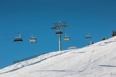 Ski lift and snow in the mountains royalty free stock images