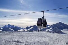 Ski lift in snow winter mountains at evening Royalty Free Stock Photos