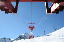 Ski lift on snowy mountain Stock Photo