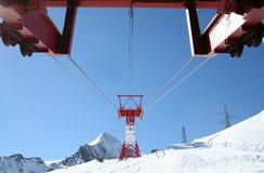 Ski lift on snowy mountain Stock Photo