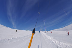 Ski lift on snowy mountain stock image