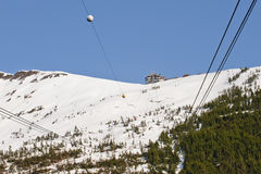 Ski lift in snowy mountains Royalty Free Stock Image