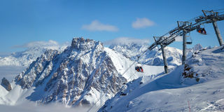 Ski lift and snowy peaks in the Alps Stock Photography