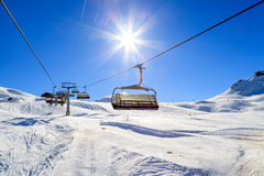 Ski lift. Snowy winter landscape and ski lift in the Alps Stock Photos