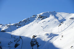 Ski lift station in mountains at winter. In Sierra Nevada Royalty Free Stock Photography