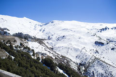 Ski lift station in mountains at winter. In Sierra Nevada Royalty Free Stock Photos