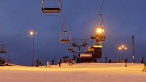 Ski lift station at night. stock video