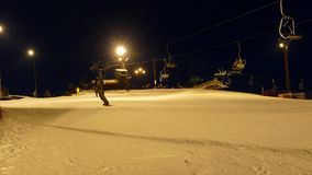 Ski lift station at night. stock video footage