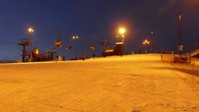 Ski lift station at night stock video footage