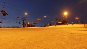 Ski lift station at night stock footage