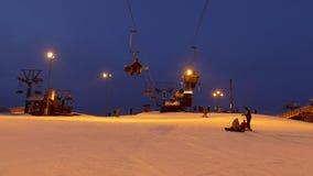 Ski lift station at night. Time lapse stock video