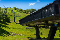 Ski lift in the summer. Ski lift base station in the summer Royalty Free Stock Image