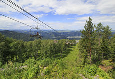 Ski lift in the summer landscape. Stock Photo