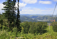Ski lift in the summer landscape. View from Mount Small Sinyuha Stock Images