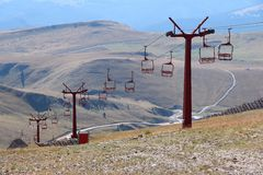 Ski lift in summer. Romania nature - summer view of ski lift infrastructure in Bucegi Mountains Royalty Free Stock Image