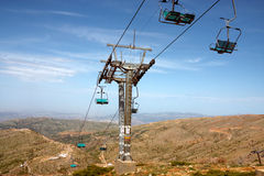 Ski lift at summer. View at summer of high mountains with ski lift Royalty Free Stock Images