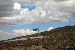 A ski lift at the summit of a mountain pass Royalty Free Stock Photos